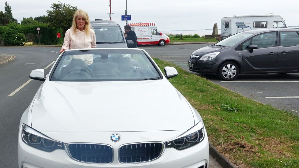 Melissa in her new BMW car