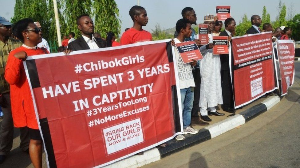Protesters hold placards during a demonstration marking the third anniversary of the abduction of the Chibok girls in Abuja on April 14, 2017