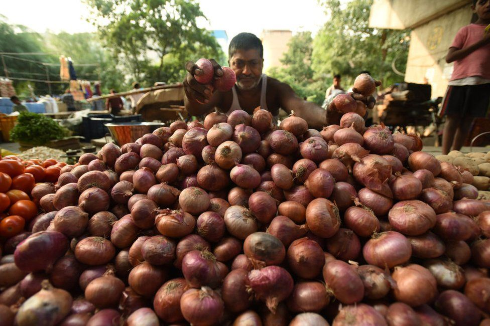 Vegetable vendors sell onions by the road, at Sector 25 on September 24, 2019 in Noida, India.