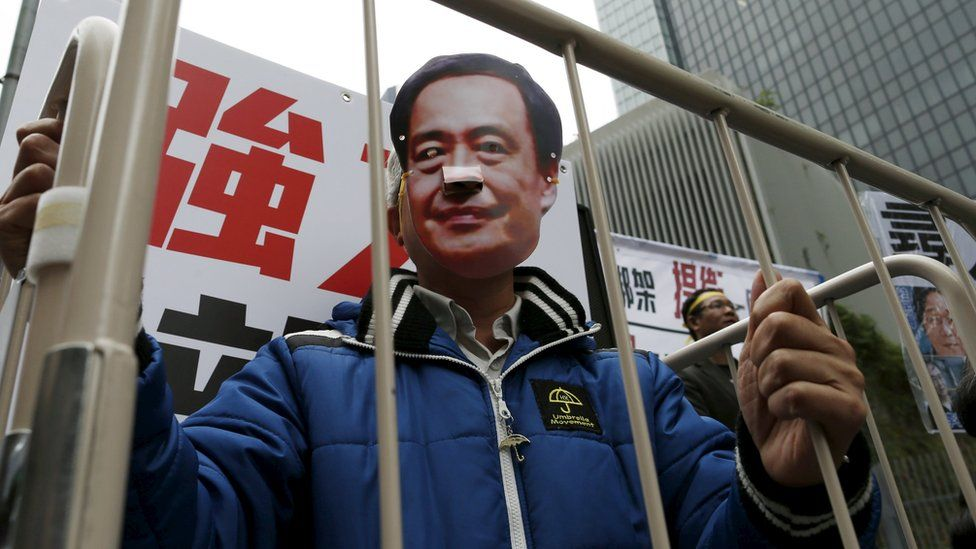 A protester in Hong Kong demonstrates against the disappearance of five people working for a bookshop