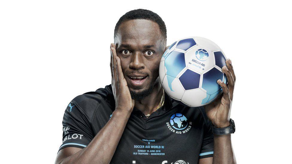 Usain Bolt with a football
