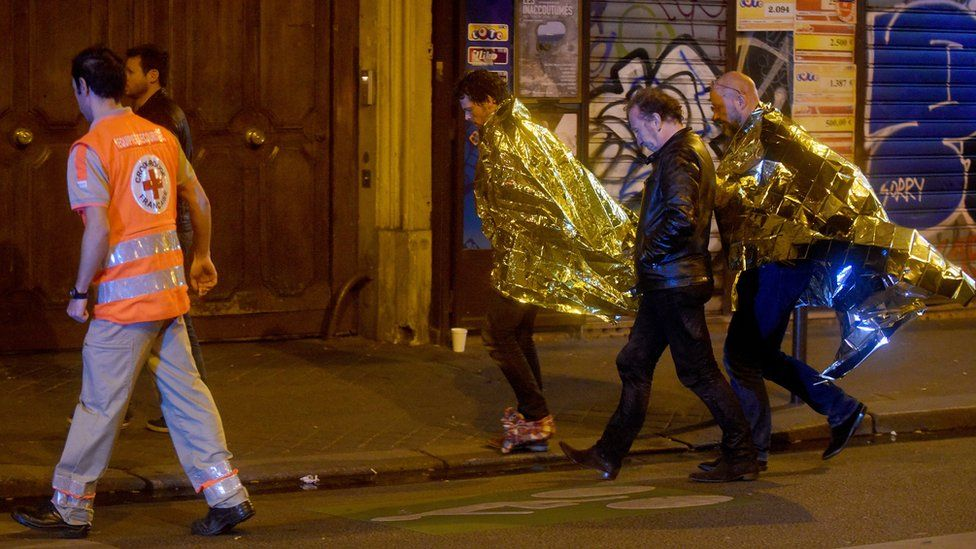 Survivors from the Bataclan leave the area