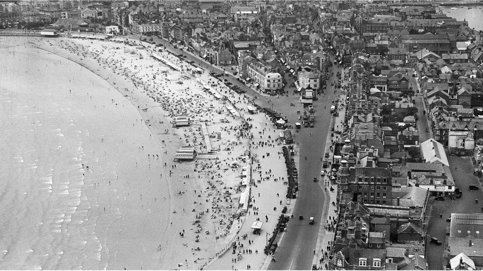 An aerial view of the Esplanade, the beach and the town in Weymouth, Dorset, taken in August 1932