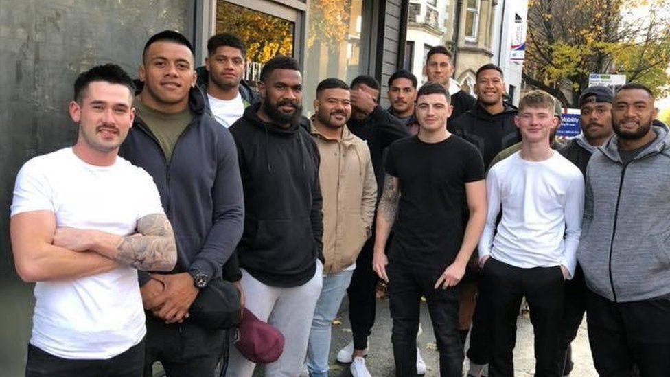 Liam O'Brien and Australia rugby players outside Office Barbershop in Cardiff