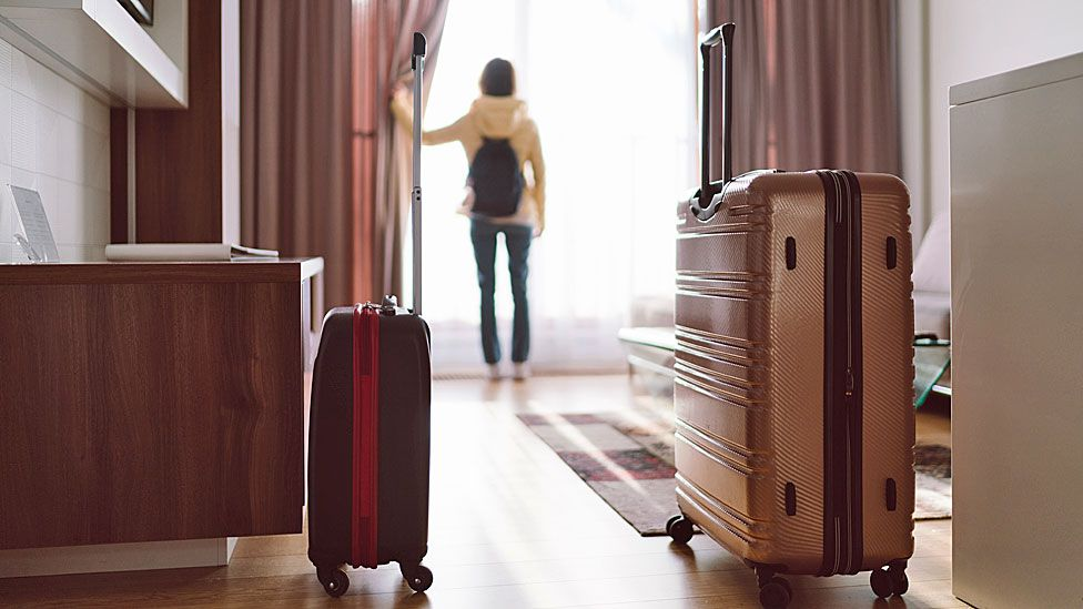 Suitcase in hotel room