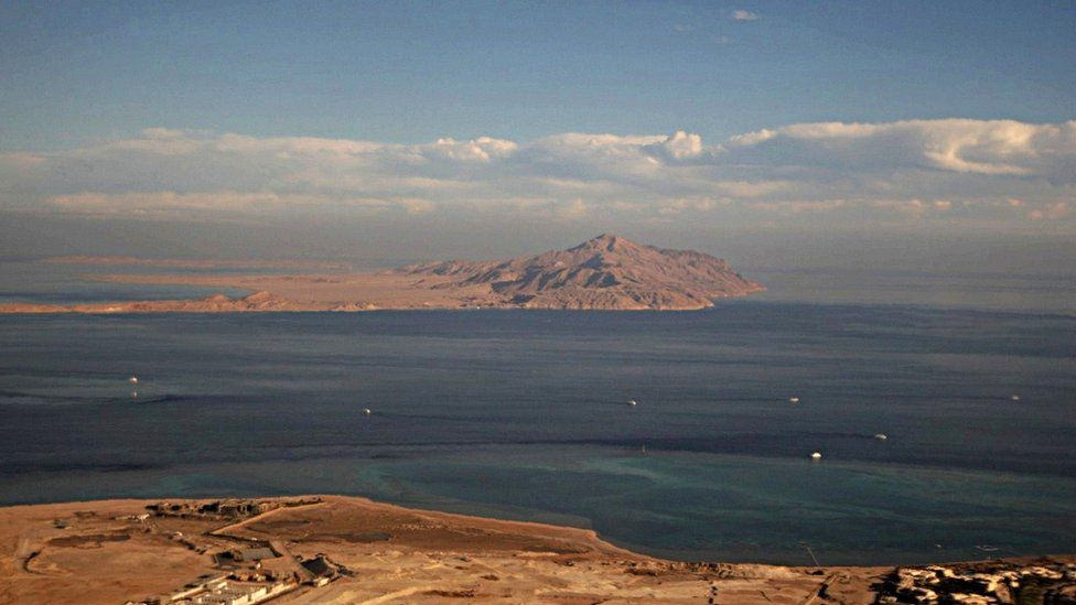 Stock picture of Tiran island and, behind it, Sanafir island in the Red Sea