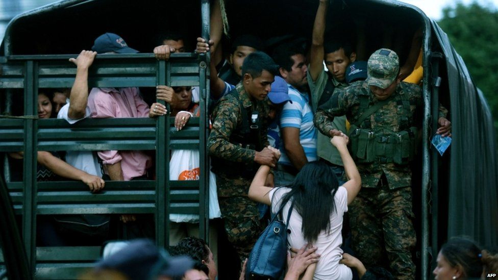 Soldiers guard a vehicle that is used to transport people in San Salvador on July 29, 2015, during the third day of a transport strike in El Salvador over the lack of security in the violence-plagued country.