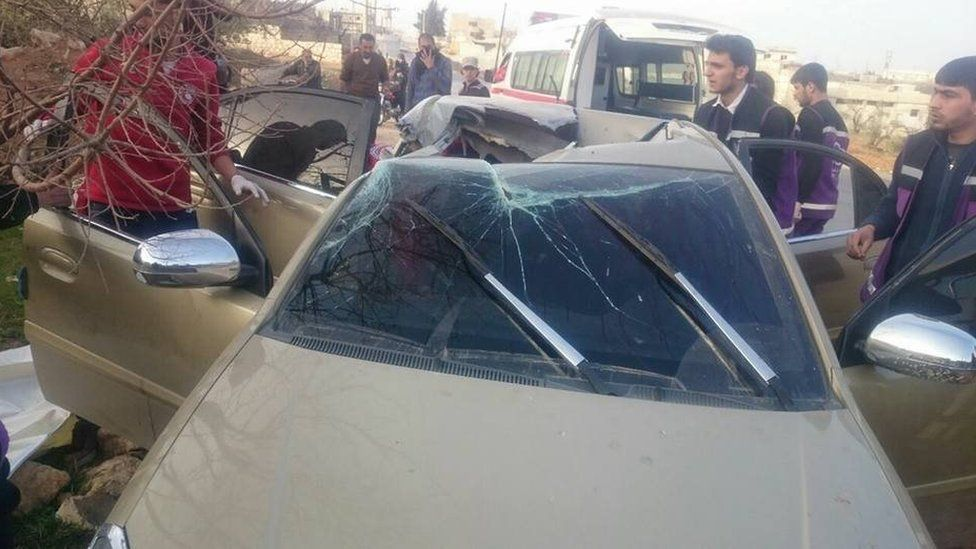 Car with roof shattered is shown in photo taken from Syrian opposition activists Local Co-ordination Committees' Facebook page