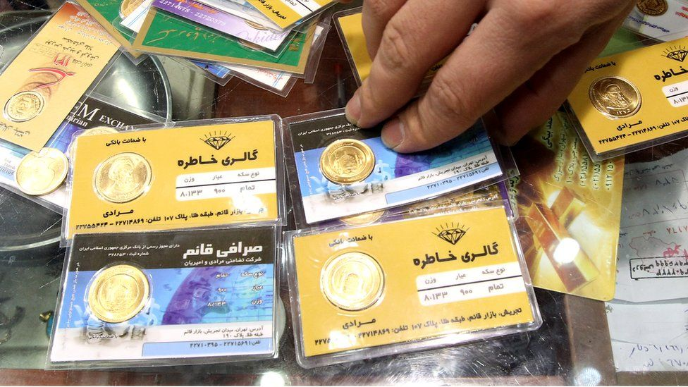 Gold coins are exchanged in Tehran as the Iranian currency, the rial, continues to lose value against the US dollar, 23 January 2012
