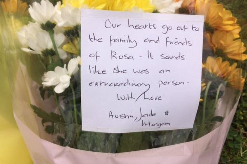 A floral tribute left at the zoo reads: Our hearts go out to the family and friends of Rosa - It sounds like she was an extraordinary person, with Love Austin, Jade & Morgan