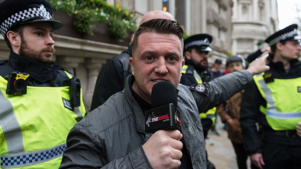 Tommy Robinson in front of police officers