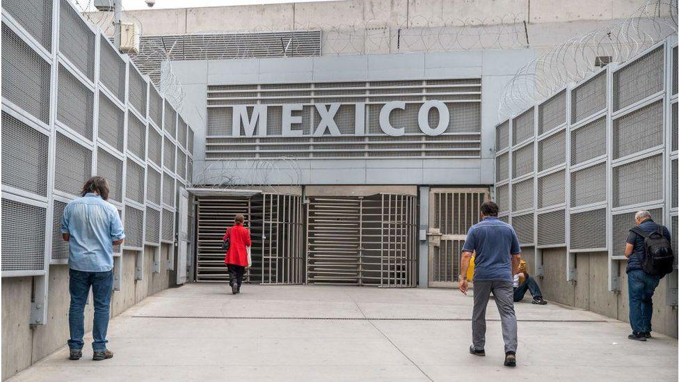 People walk towards Mexico from San Ysidro, California