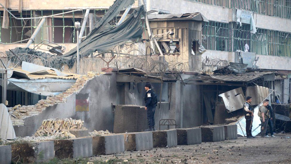 Afghan security personnel inspect the site of an attack targeting the German consulate in Mazar-i-Sharif on November 11, 2016.