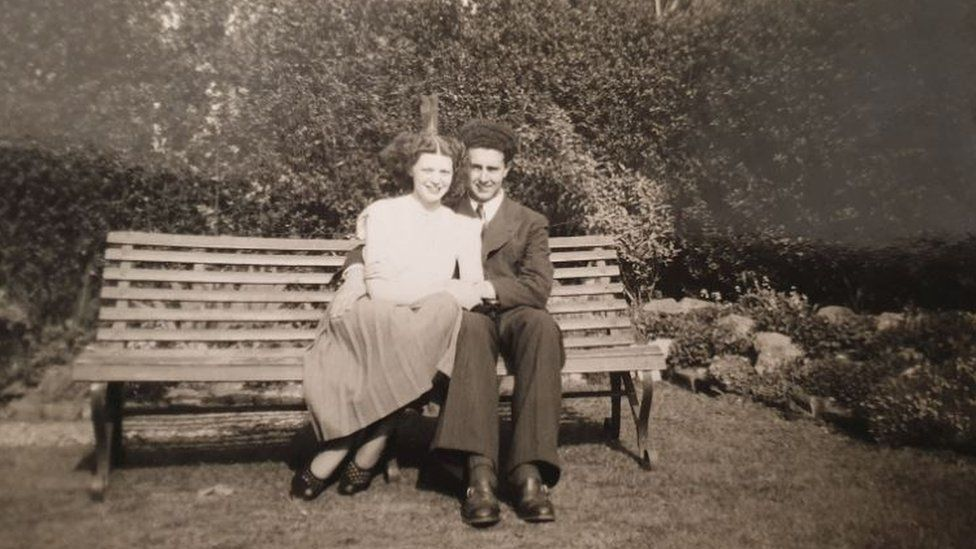 Norma and Bob Beasley on a bench looking very much in love