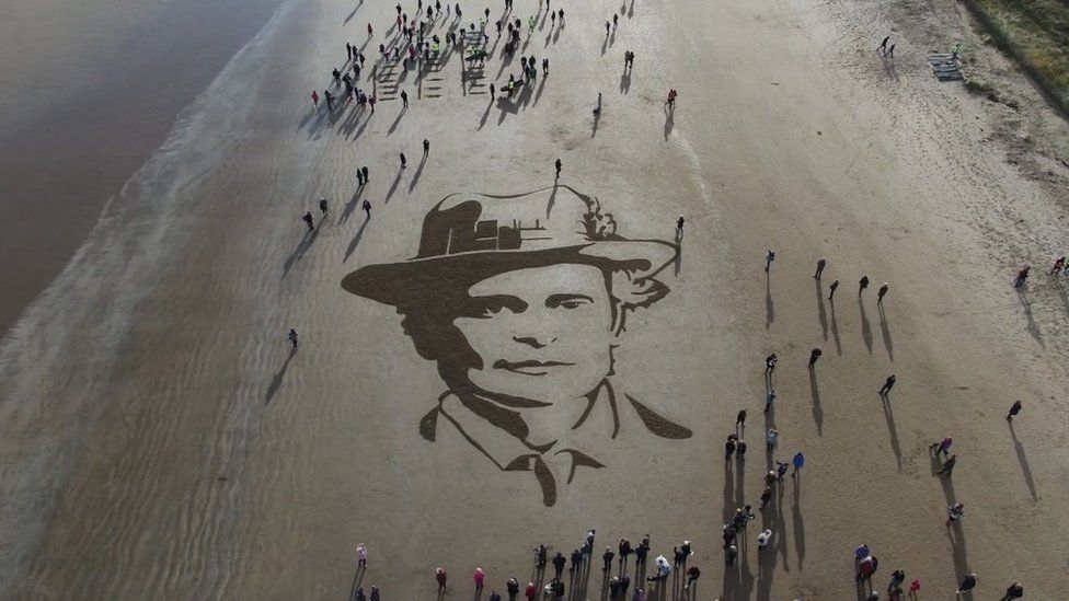 A large portrait of Dr Elsie Inglis has been raked into the sand on West Sands beach in St Andrews