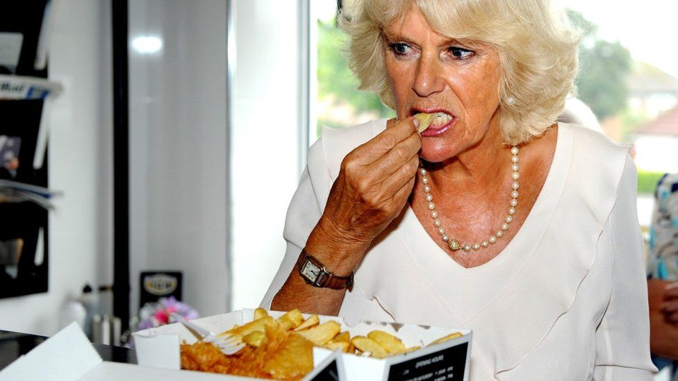 Camilla, Duchess of Cornwall, samples haddock and chips while visiting Bridlington in 2013