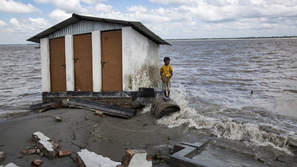 A boy who lost their belongings in river erosion takes shelter in a shelter home which is now eroded again.