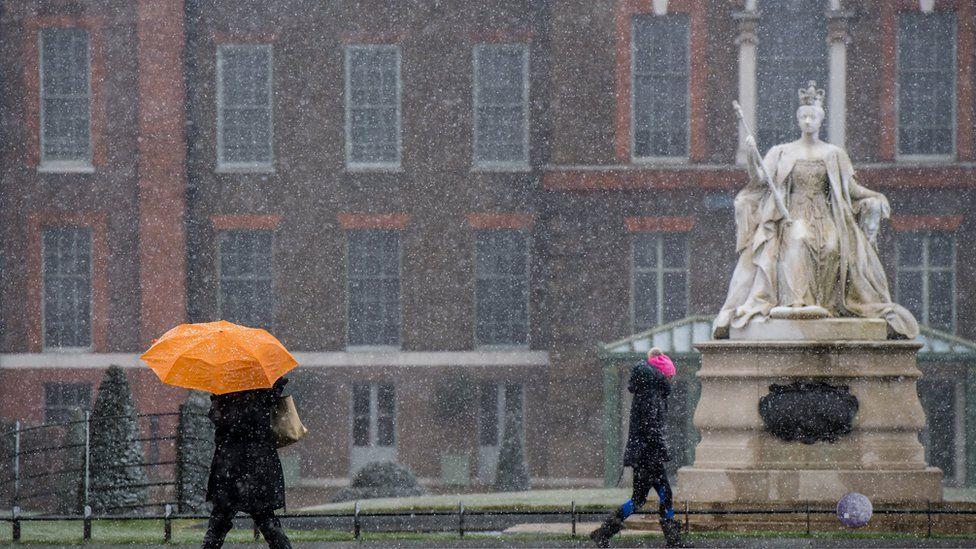 Snow falling outside Kensington Palace