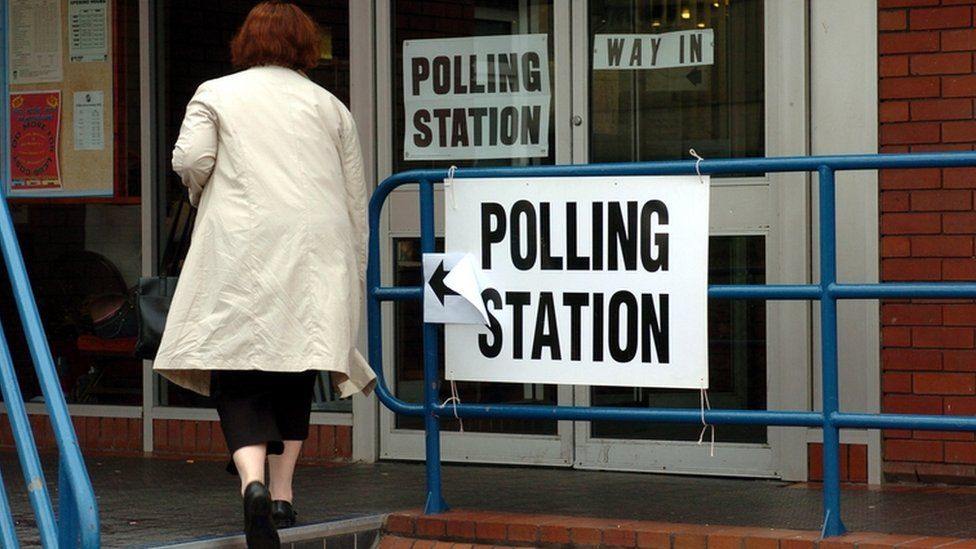 Woman entering polling station