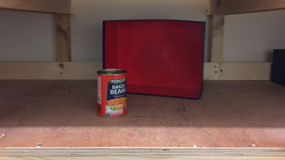 A shelf with just one tin of beans