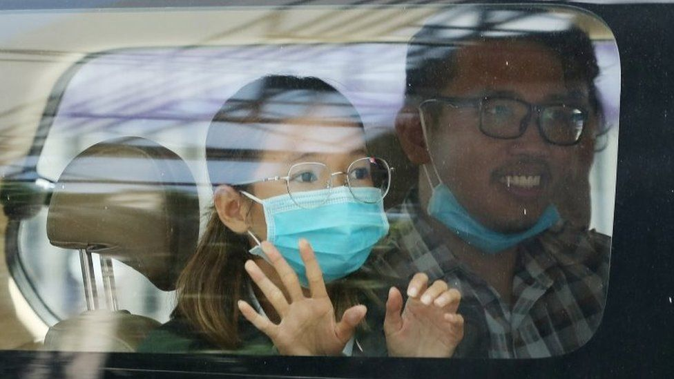 A handout photo made available on 22 June 2021 by Cambodian Human Rights Organization LICADHO shows environmental activist Sun Ratha (L) sitting in a police van near the Municipal Court in Phnom Penh, Cambodia, 19 June 2021 (issued 22 June 2021).