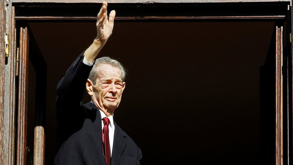 Romania's former King Michael waves during a ceremony celebrating both his 92nd birthday in 2013