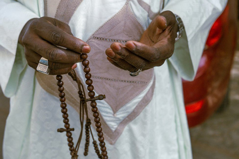 Mamadou Diokhame carries prayer beads in his hands