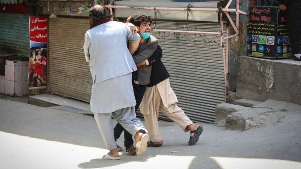 6 An Afghan man reacts at the scene after an attack at MSF (Doctors without Borders) clinic in Kabul, Afghanistan, 12 May 2020.