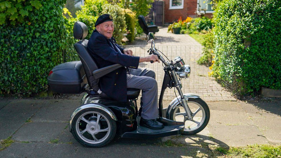 Former soldier Ralph Harvey, 89, drives his mobility scooter during celebrations for the 75th anniversary of VE Day on May 08, 2020 in Redcar, United Kingdom
