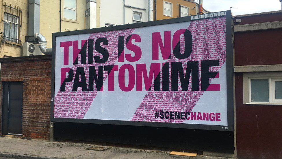 A billboard reading: This is no pantomime