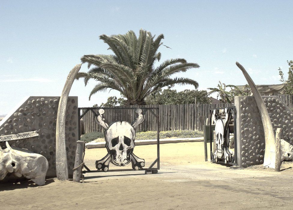 A gate covered in skull and crossbones