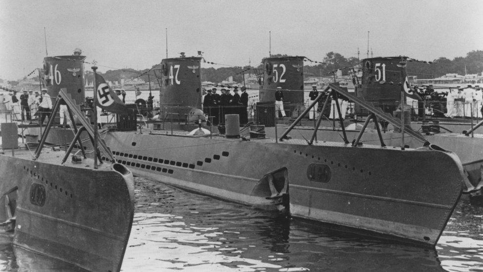 U-47, a Type VIIB U-boat submarine of the German navy (Kriegsmarine) while tied up alongside the U-46, U-52 and U-51 Unterseeboot at the Germaniawerft naval base on 1 August 1939 in Kiel, Germany