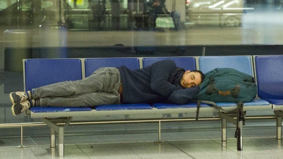 A man asleep at Heathrow Airport