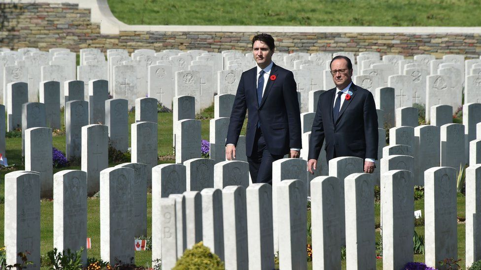 Francois Hollande and Justin Trudeau walk in the Canadian WW1 military cemetery in Vimy