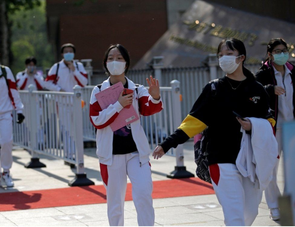 Students wearing face masks leave a school in Beijing, China as senior high school students in the Chinese capital returned to campus following the coronavirus disease (COVID-19) outbreak, April 27, 2020.