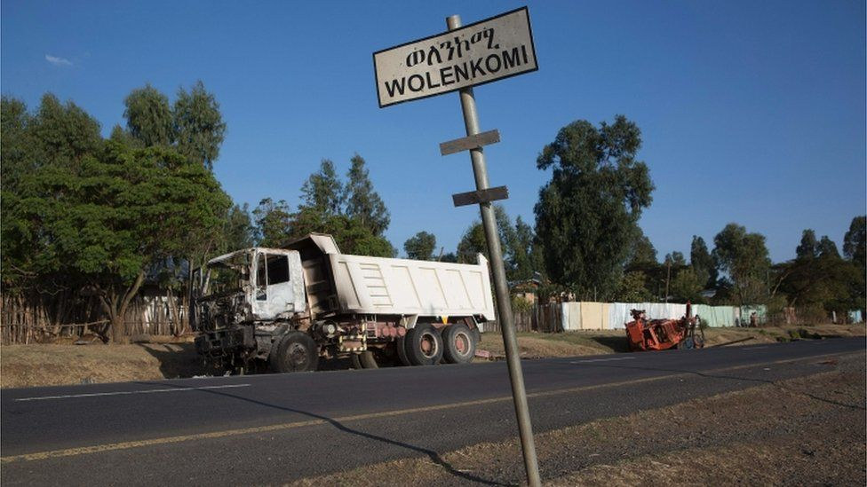 A burnt out truck, assumed to be set fire by protesters, lies outside the village of Wolenkomi