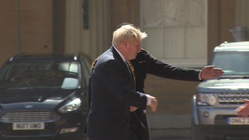 Boris Johnson arrives at the Palace