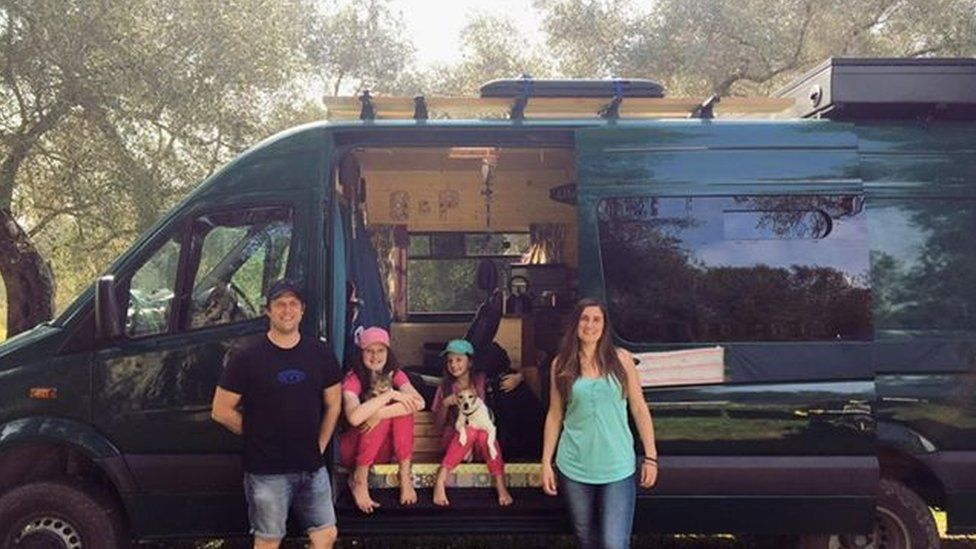 The Thacker family in the olive grove with their van