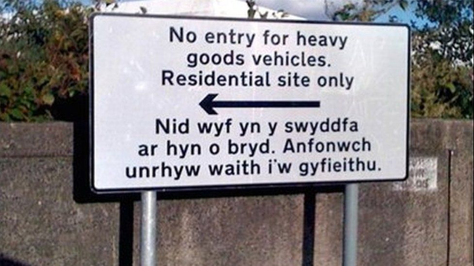 """Swansea council road sign reading: """"I am not in the office at the moment. Send any work to be translated"""""""