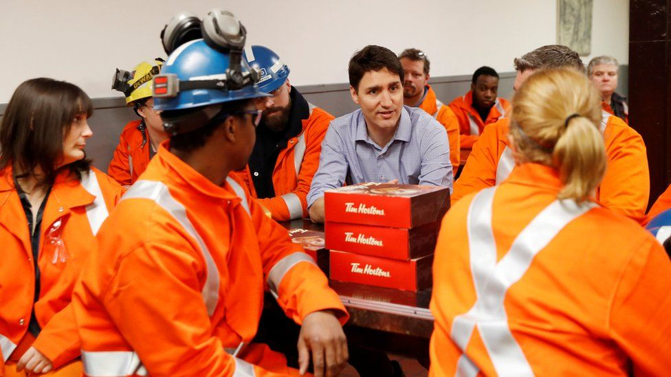 Canada's Prime Minister Justin Trudeau meets with steel workers from Stelco Hamilton Works, in Hamilton, Ontario, Canada