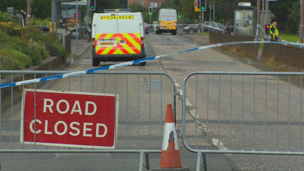 Road closed sign at scene