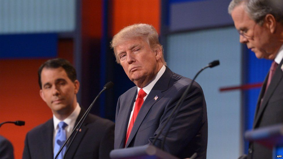 Republican presidential hopeful Donald Trump listens during the prime time Republican presidential primary debate - 6 August 2015