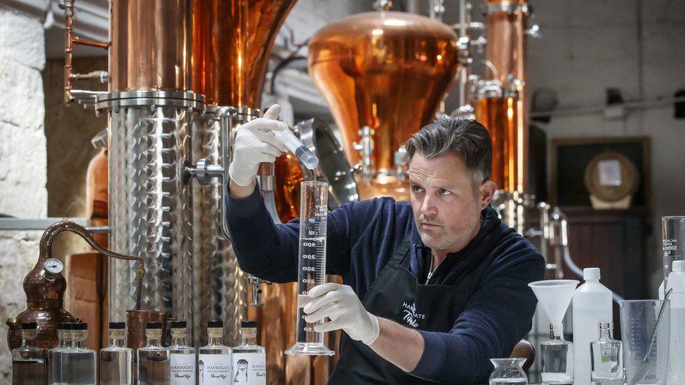 A gin distiller using his facilities to make hand sanitiser