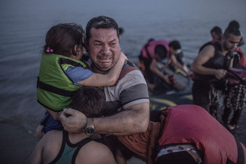 Laith Majid, holding his son and daughter in his arms