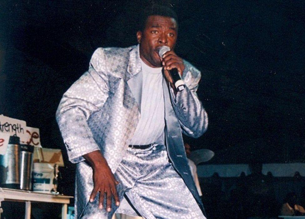 Trevor 'King Zacari' King wearing a silver suit