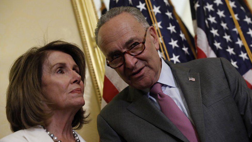Nancy Pelosi and Chuck Schumer talk at the Capitol.