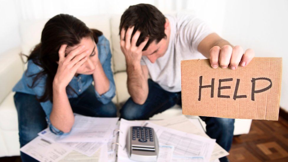 Man and woman in financial difficulty