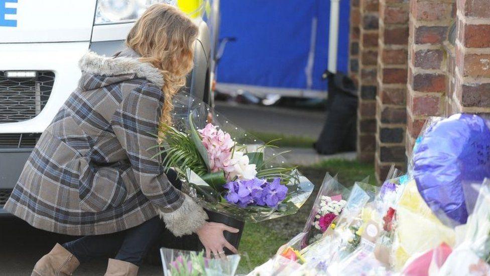 Lydia Wilkinson placing flowers
