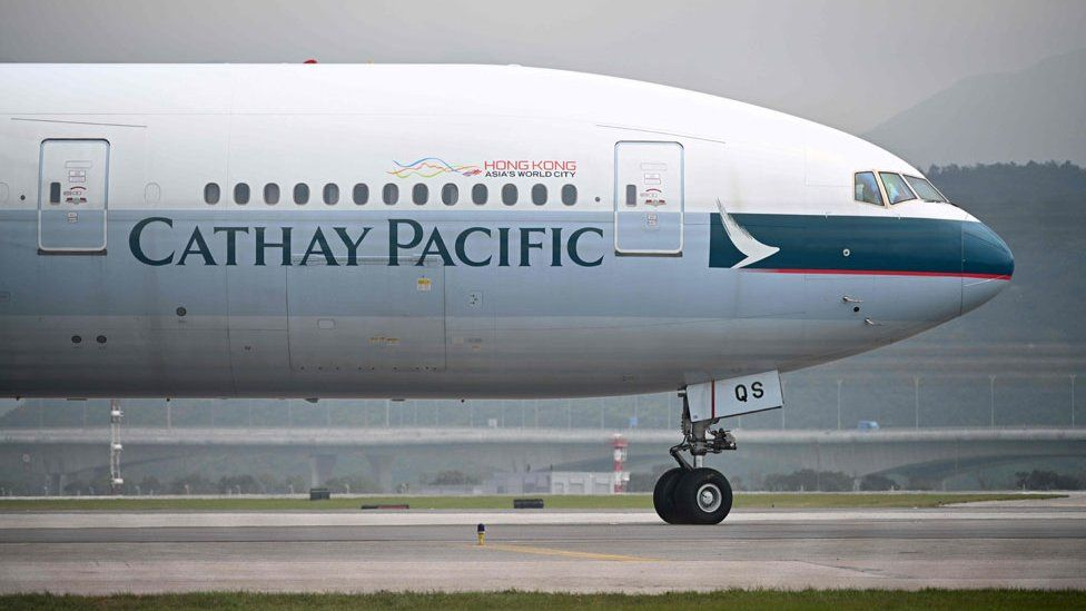 A Cathay Pacific plane lands on the tarmac