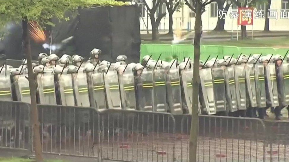 Screen grab from the PLA's anti-riot video - shows lines of riot police with shields and batons